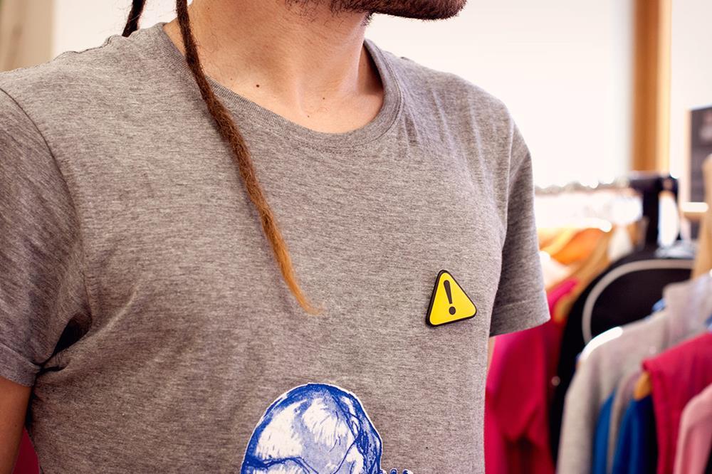 Triangular pin badge buttons